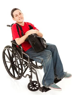 Student in a wheelchair smiling