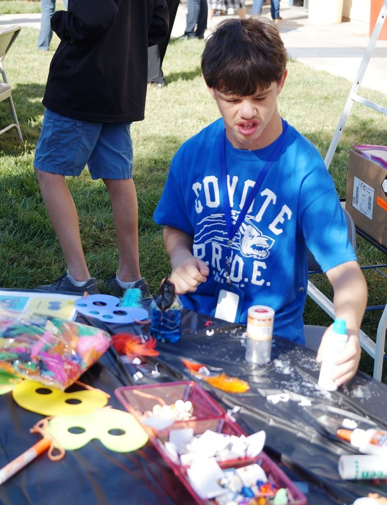 Student working on an art project at the Fall Festival