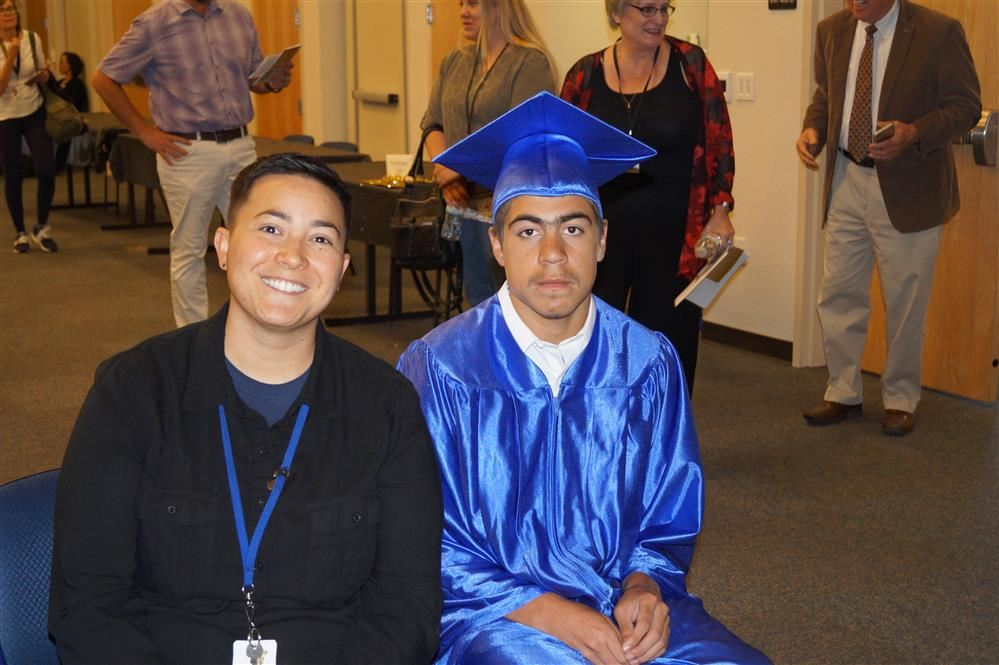 Teacher with a male student at Sp. Ed. Promotion Ceremony.