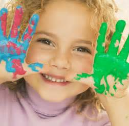 Girl with green paint on her hands