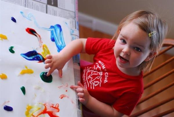 Young girl fingerpainting